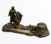 Orientalist Inkwell, (Austria, 20th century), representation of a carpet seller in a landscape in polychrome painted metal glass of the inkwell intact, 12 x 22 x 9 cm