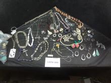 Huge lot of costume jewelry in a leatherette jewelry box, all one money