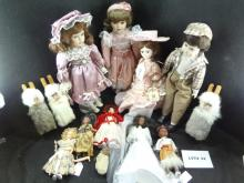Huge lot of mixed items, seven banks, Mammy and Pappy wood figures, and a Rollytoy figure, three dolls in Pink, one is a Bradley doll and two are 16