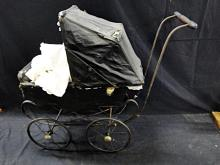 Antique doll carriage with antique doll