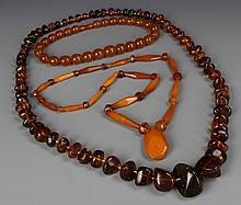 Three Chinese Amber And Wax Necklaces