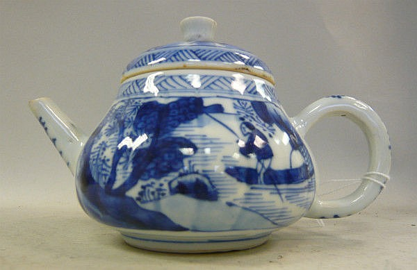 An early 18thC Chinese porcelain teapot of squat,