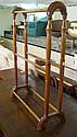 A modern Victorian style pitch pine towel rail,