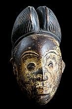 An interesting wood 'Punu' mask, Gabon 19th century