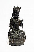 A burnished bronze China 'Guanyin' sculpture