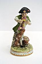 A lovely polychrome porcelain Meissen sculpture