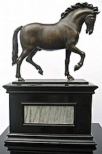 A bronze sculpture of an horse after Giambologna's model
