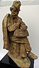 A Terra Cotta Sculpture of a Fisherman