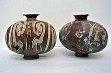 A pair of Chinese terra cotta vases