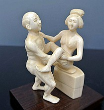 An erotic ivory carved sculpture