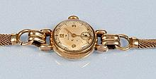 Rolex: a lady's 9ct. gold bracelet watch, the circular arab