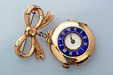 A 9ct. gold cased fob watch, of half hunter form, blue and