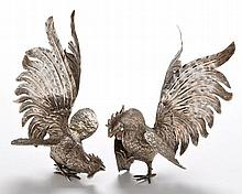 A pair of fighting cockerel ornaments, 8 3/4in. (22.5cms) h