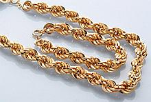 A 9ct. yellow gold matching necklace and