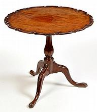 A George III mahogany tip-up-top occasional table, the shap