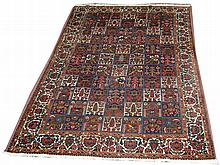 A Baktian rug, the field decorated with squares of floral m