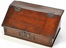 An 18th Century oak bible box, the hinged lid attached with