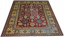 An Zegla style carpet, with flowerhead motifs on claret gro
