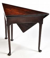 A George III mahogany drop leaf corner table, the