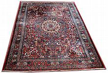 A Birjand carpet, the central circular foliate medallions s