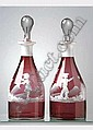 [ Glass ] A fine pair of Mary Gregory type 9in. cranberry circular tapered decanters, painted children in landscapes, with clear circular tapered stoppers. See illustration