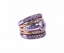 A gold and white gold band ring