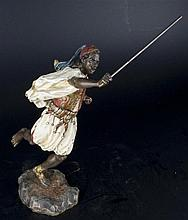 A COLD-PAINTED BRONZE FIGURE OF RUNNING ARAB WARRIOR.