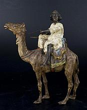 A COLD-PAINTED  BRONZE FIGURE OF ARABIC WARRIOR ON A CAMEL.