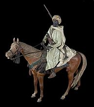 A COLD-PAINTED BRONZE FIGURE OF ARAB-HUNTER ON HORSEBACK.