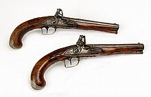 A Pair of Silver-Mounted Flintlock Pistols by T.W. Pistor