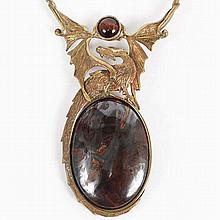 Hand made jewelry; Dragon motif necklace in layered metal with hardstone medallion.