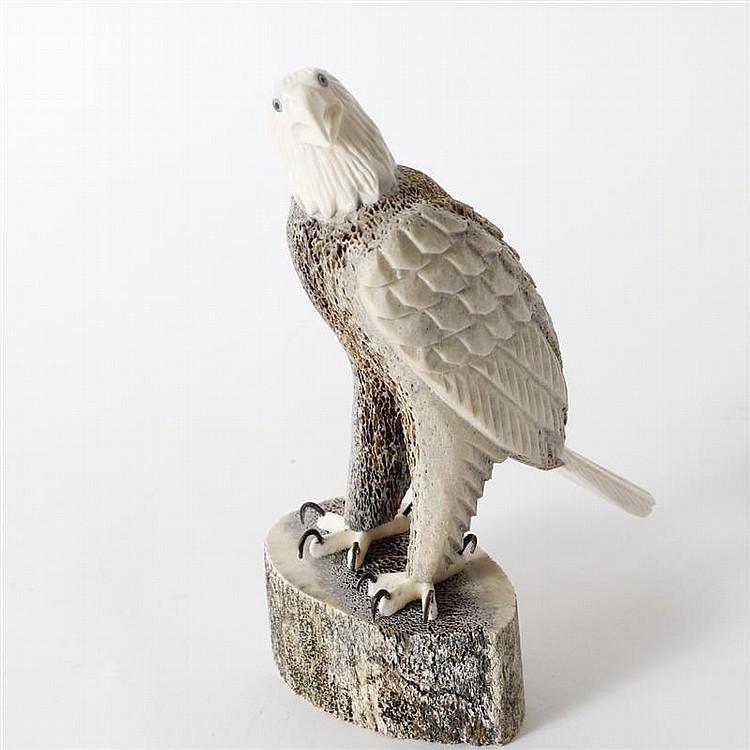 Inuit carved eagle figure fossilized whale bone and alaskan