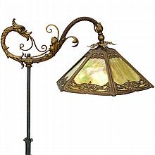 Ornate victorian floor lamp with water dragon and polychrome floral and foliate base.