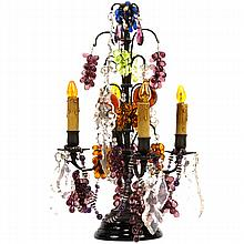 French table lamp with prisms, glass bead garland, balls, fruit and black glass base.