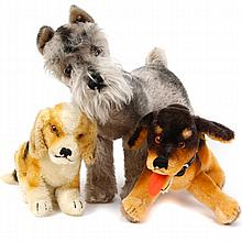 Three Steiff mohair dogs including Schnauzer Tessie, vintage plush animals.