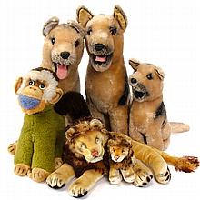 Six vintage plush animals; Steiff Mungo monkey and 2 mohair lions along with 3 Dakin German Shepherd dogs.