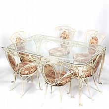 Wrought Iron garden furniture dining table and chairs with toile fabric.