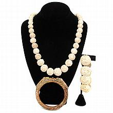 Three pieces vintage costume jewelry; French bakelite cicada bangle bracelet and carved meerschaum rose bead necklace and bracelet.