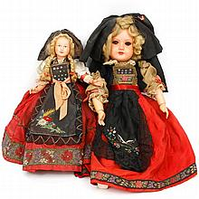 Pair of vintage dolls in traditional French costume; celluloid and composition.