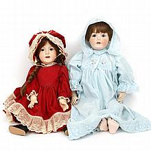 Pair of German Mildred E. Smith reproduction Kestner and JDK bisque head dolls.