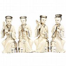 Group of four Chinese carved ivory figures of women playing instruments