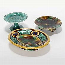 Three Majolica pedestal dishes; Wedgwood shell plate on shell form feet, and green maple leaf stand.