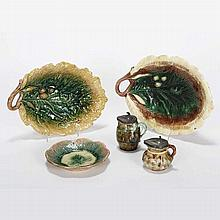 Four pieces Etruscan / Victorian majolica; two oak leaf platters with acorns, two syrup pitchers with pewter lid, and small plate.