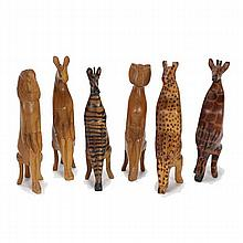 Six carved African whimsical safari animal figures seated on stools;