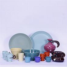 Eighteen Metlox Art Pottery pieces; 4 baked potato dishes, carafe, tumblers, custards, planter, mixing bowl, & 2 plates.