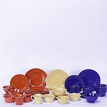 Thirty Pacific Art Pottery pieces; plates, cups, saucers, ramekins, bowls, & sherbet.