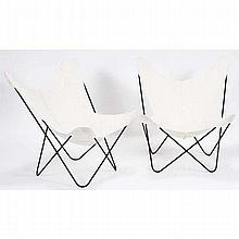 Two black metal framed butterfly chairs with linen seat covers.