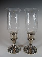 Pair of Wild Rose International sterling hurricane lamps