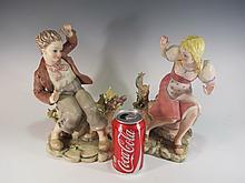 Old pair of Italian ceramic statues
