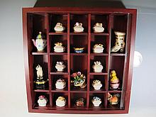 Display cabinet with 20 porcelain boxes